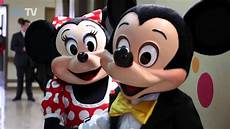 mickey and minnie mouse visit children at the