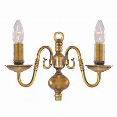 flemish solid antique brass 2 light wall bracket with metal candle covers astral lighting ltd