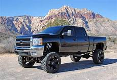 White Lifted Chevy Truck Wallpaper
