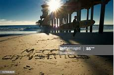 merry christmas written in sand getty images
