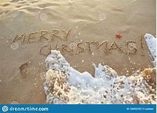 the inscription merry christmas the sand the stock image image of christmas sand