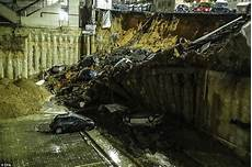 rome sinkhole swallows cars and evacuates buildings