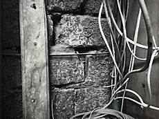 free of black and white brick wall electrical wires