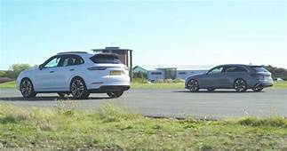 Watch Porsche Cayenne Take On Audi RS4 In Series Of Drag Races