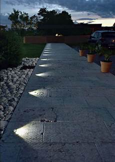 recessed in ground lighting suddenly turns this pathway into a nightime feature lighting in