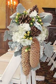 pew flowers with pinecones silver dusty miller white