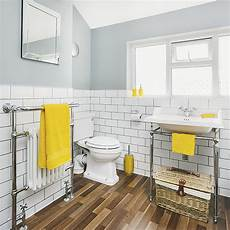 yellow and gray bathroom ideas white and grey bathroom with yellow accents and faux wood flooring ideal home