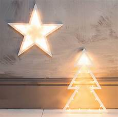 tree or star light up decorations by the forest co notonthehighstreet com
