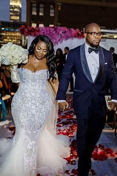 couples photos fashionable couple walking up aisle inside weddings