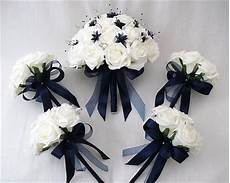 wedding flowers brides with 4 bridesmaids posy bouquets