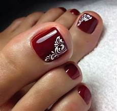 simple red burgundy toe nails with swirl accent in 2019
