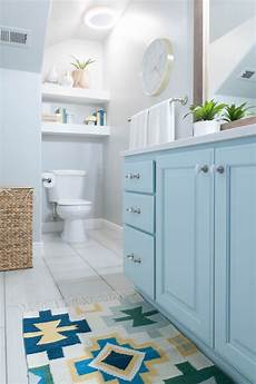 kids bathroom remodel with pops of light turquoise yellow and green turquoise bathroom