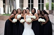 brides bridesmaids photos black bridesmaid dresses hydrangea bouquets inside weddings