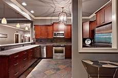 atlanta color taupe paint kitchen traditional with trim cabinet doors pendant lighting