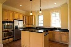 best wall paint color for honey maple cabinets visual motley
