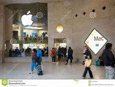 apple store next to the louvre museum editorial image 34737483