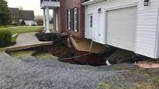 worried neighbours seek answers as sinkhole swallows n s