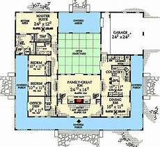 spanish style house plans with central courtyard central courtyard dream home plan 81383w 1st floor