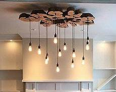 wohnzimmer stehle modern olive wood live edge light fixture earthy rustic