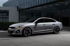 the new 2021 kia k5 is a gorgeous mid size sedan with the power to match shouts