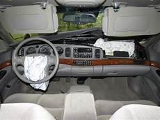 2000 buick lesabre interior features iseecars com 2000 buick lesabre interior rear view mirror 5 00 cust onstar comp 2454012 267 gm4u00