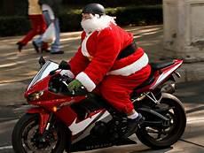 weihnachtsmann auf motorrad gif going to sleep while we wait for santa the new york times
