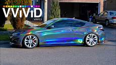 car wrapping folie vvivid holographic black chrome in sunlight