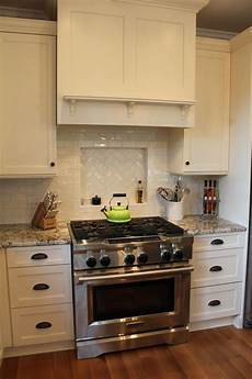white ceiling fan subway kitchen backsplash ideas subway tile niche in the backsplash above the stovetop