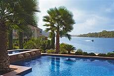 a grand lakeside home with rustic a grand lakeside home with rustic charm pool water