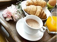 fiori coffee breakfast with coffee flower and croissants stock