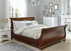 our orleans wooden bed frame is finished with an exquisite