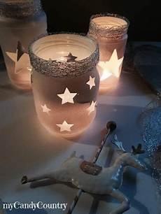 candele fai da te natalizie riciclo creativo barattoli decorati per natale