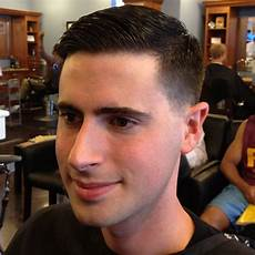 this is a classic taper the hair is cut aggressively close around the sides and back a close