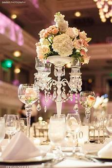 elegant wedding table with white and pink flowers and gorgeous reception room lighting wedding