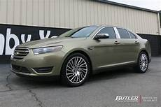 ford taurus with 20in lexani wraith wheels exclusively