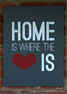 home is where the heart is stenciled sign and giveaway sweet pea