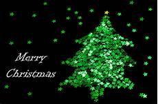 photo of green star christmas tree free christmas images