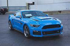 roush shows off pair of grabber blue mustangs carscoops