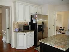 diamond prelude kitchen cabinets bolton maple by diamond prelude cabinetry ivory with coco glaze java island traditional