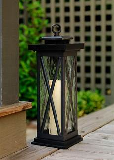 this solar lantern would blend right in with traditional patio furniture with black accents or