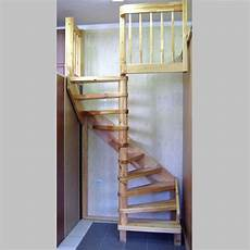 rustic natural wooden spiral stairs for small space for home interior as well gray tile floor