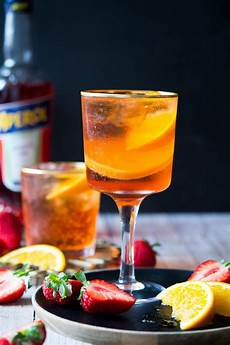 Aperol Spritz Cocktails - aperol spritz cocktail inside the rustic kitchen