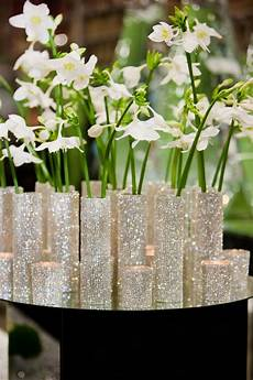 christmas centerpiece with white flowers in sparkling small slim vases to add sparkle at new