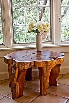 baumstamm tisch der eyecatcher im rustikalen wohnzimmer