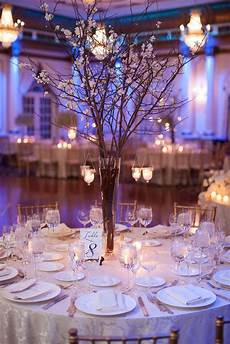 whimsical branch centerpiece with hanging candles