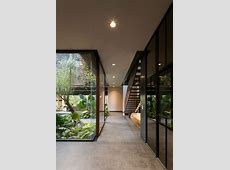 indoor glass hallway with nature view
