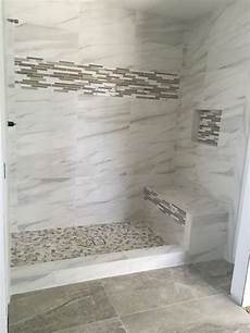 like the tile border and the floor powder marble tile look a like with our stock 18x36 anthology