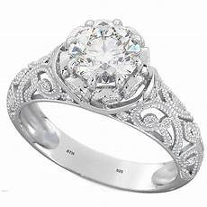 vintage style floral discovery solitaire engagement ring