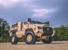 elon musk says their awaited electric truck will like quot an armored personnel carrier