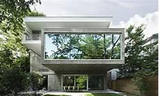 4 homes using concrete as a stylish angela tsementzis canadian concrete house wallpaper